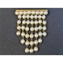 Broche ancienne formant rideau de perles