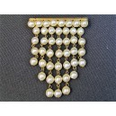 Old brooch forming bead curtain