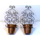 Pair of wrought-iron wall-mounted pot holders and Goardère copper cork-pots