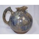 Stoneware pitcher circa 1950 stamped Reflex