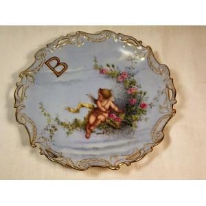 Assiette en porcelaine ancienne décor de Chérubin